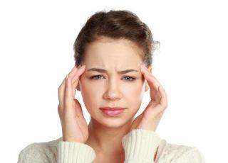 Ból głowy, kobieta