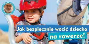 dziecko w kasku w foteliku rowerowym
