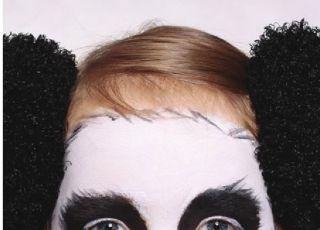 Dziecko z pomalowaną buzią - Panda