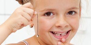 zęby mleczne, zęby stałe, dziecko, wyrywanie zęba, ząb